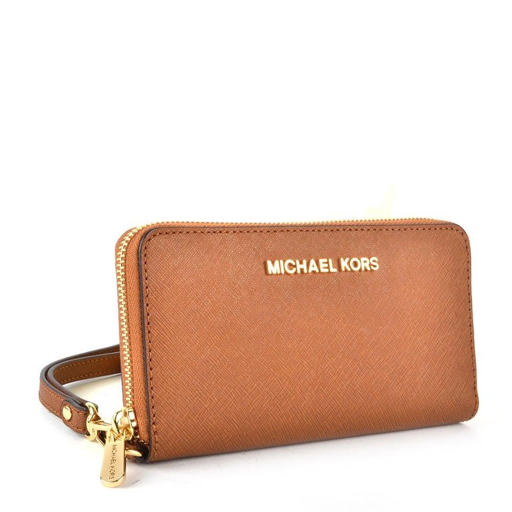 a9dbf17c5d44 Michael Kors Phone Wristlet Purse. MICHAEL by Michael Kors Jet Set Travel  ...