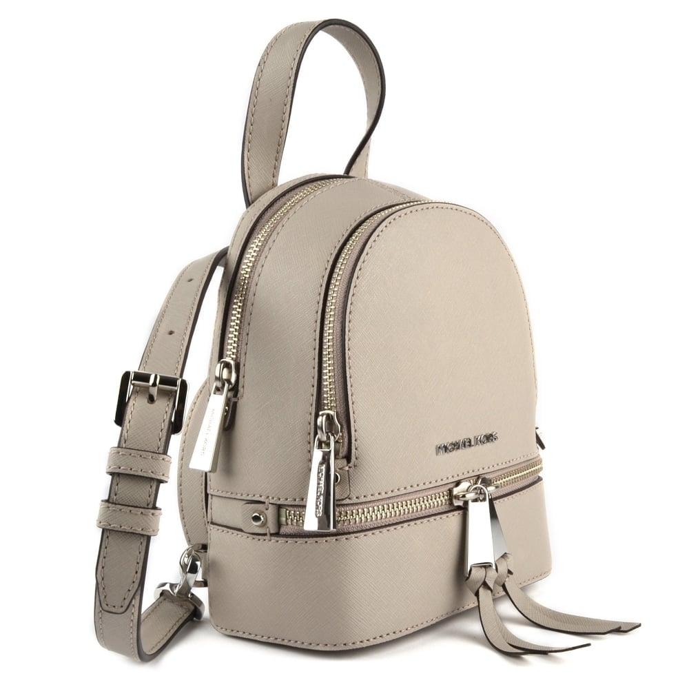 c47c743d9ce2 MICHAEL MICHAEL KORS Rhea Zip Cement Extra Small Messenger Backpack