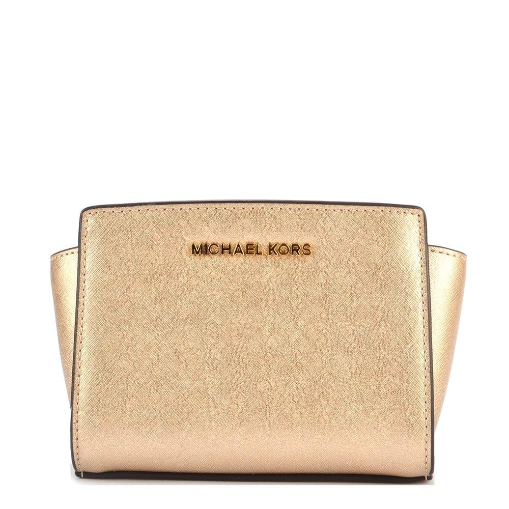 a94df97a6ff6 MICHAEL by Michael Kors Selma Mini Pale Gold Saffiano Messenger Bag ...